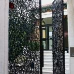 A gate in metal and glass designed by Claire Falkenstein for the Peggy Guggenheim collection in Venice