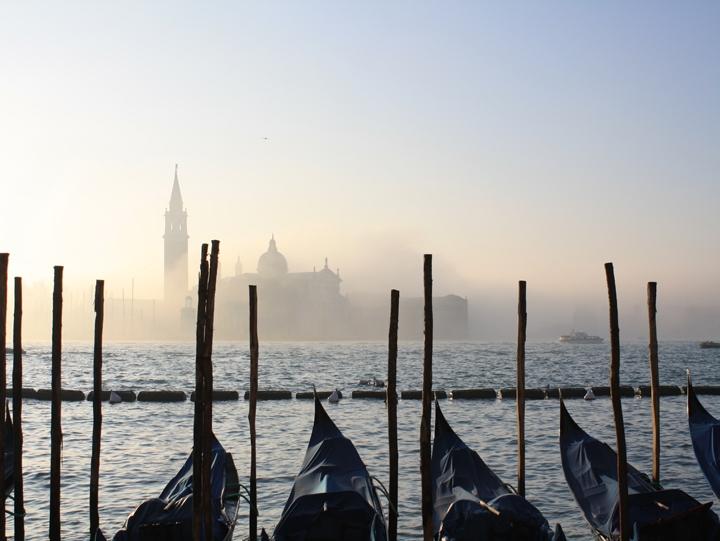 Gondolas in front of the island of San Giorgio Maggiore in the mist in Venice